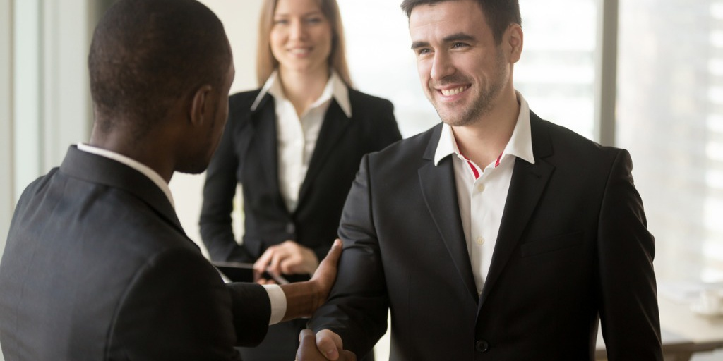 boss-welcoming-and-thanking-employee-for-good-job-picture-id843533990